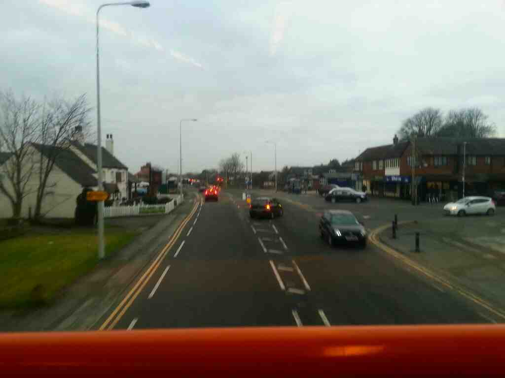 Passes the Pickwick Tavern and Harbour Lane on Lytham Rd Warton on a 68 bus