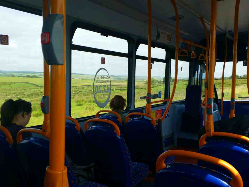 As we look across to the opposite side of the bus we can see how the landscape is wild and open on a 685 Carlisle Newcastle bus