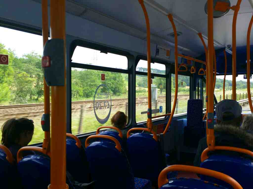 The Carlise to Newcastle railway line running alongside the A69 near Greenhead on a 685 Carlisle Newcastle bus