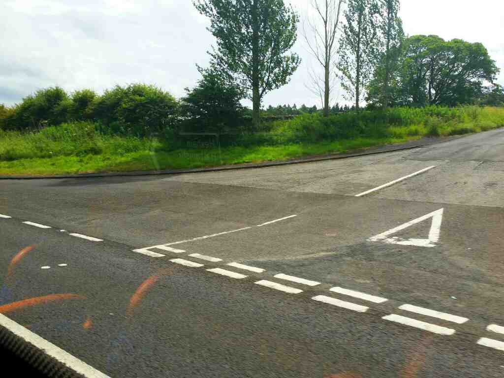 Junction of the A69 and an unamed road signed Featherstone and Lambley on a 685 Carlisle Newcastle bus