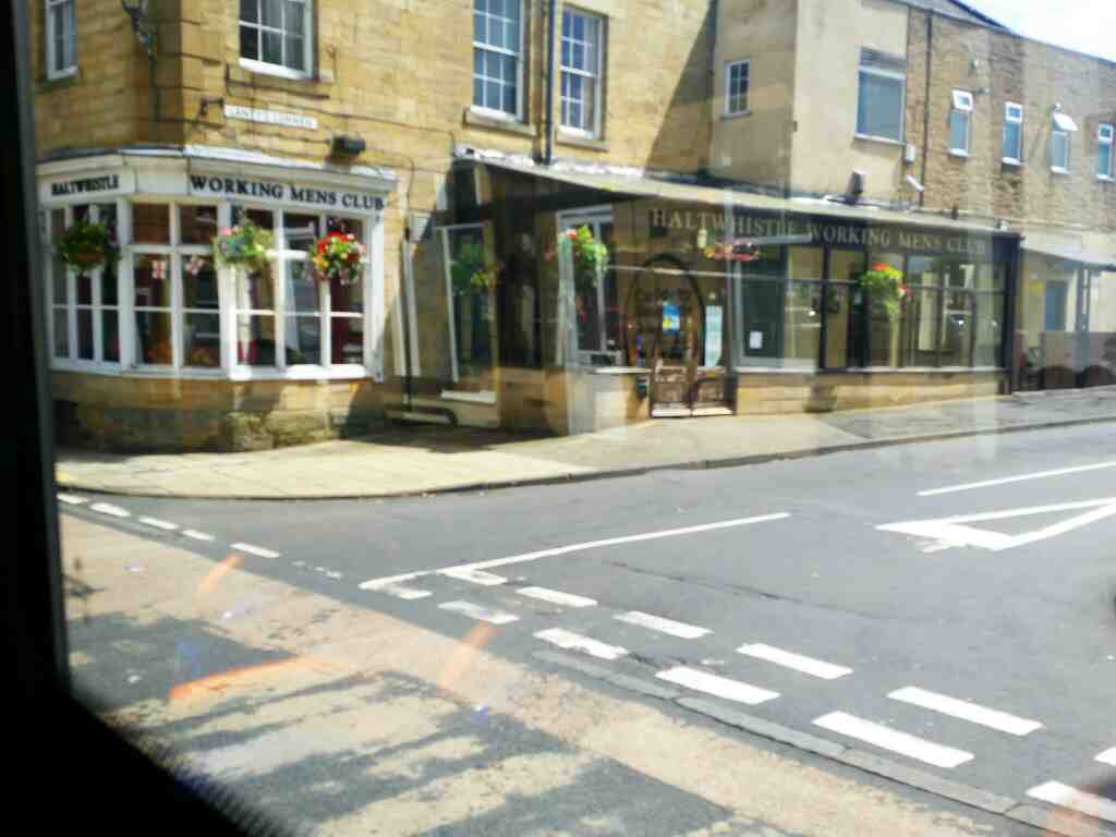 Junction of Lanty's Lonnen and Main St Haltwhistle and Haltwhistle working mens Club on a 685 Carlisle Newcastle bus