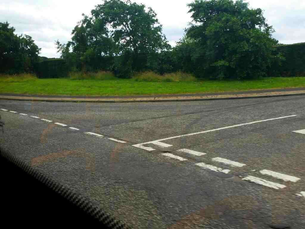 Junction of Hexham Rd and an unamed road signed Hadrians Wall Heddon on the Wall on a 685 Carlisle Newcastle bus
