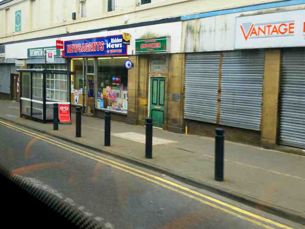 Passes shops in Throckley Hexham Rd on a 685 Carlisle Newcastle bus