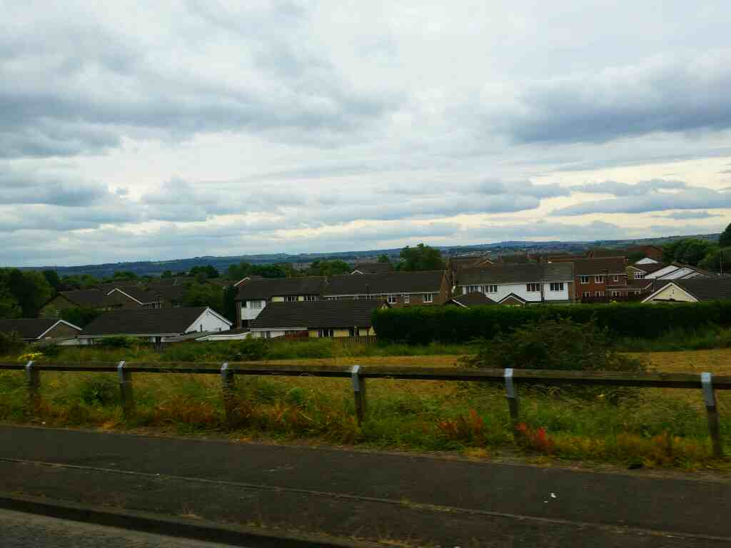 Looking across Lemington from the B6528 on a 685 Carlisle Newcastle bus
