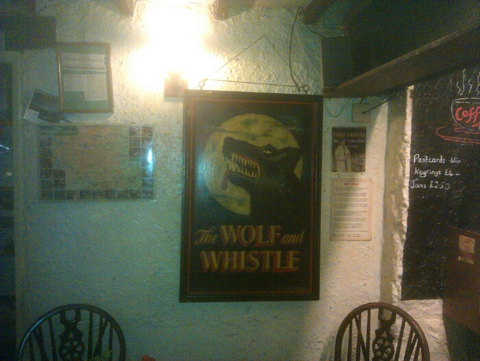 The Wolf and the Whistle. A scary pub name on the wall at Tan Hill.