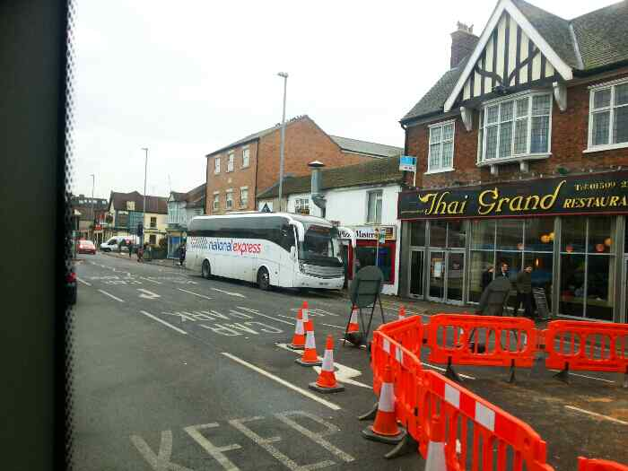 We pull up at a bus stop as we enter Loughborough town centre on the A6