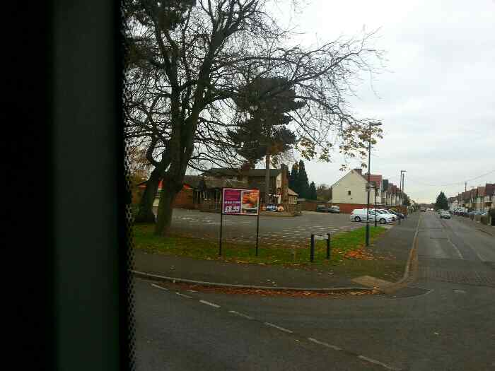 We pass The Lodge Flaming Grill Pub on the Corner of Grange Rd and Shardlow Rd on a Skylink bus