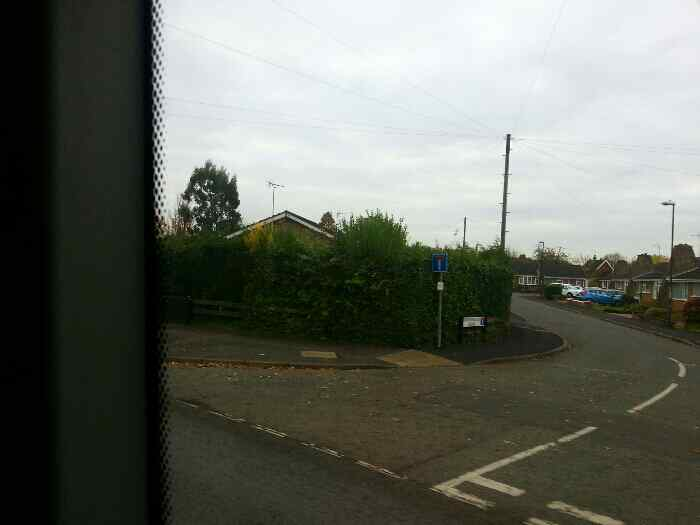 Passing the junction of Newborough Road and Shardlow Rd on a Skylink bus