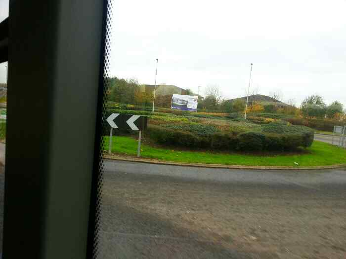 A small roundabout near Castle Donnington on Station Rd off a Skylink Bus