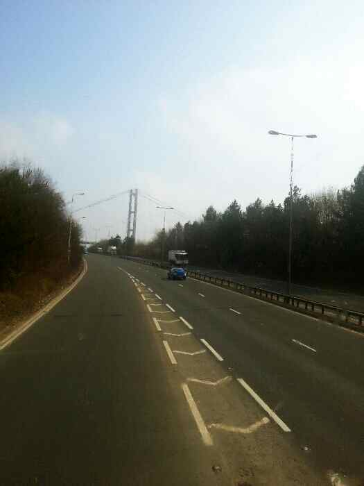 Joining the A63 about to pass under the north end of the Humber Bridge.