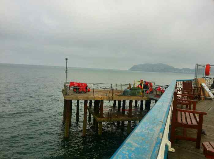 Concrete landing stage at end of Llandudno pier now used for fishing