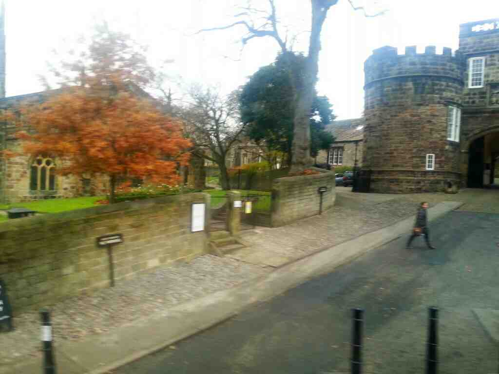 Passes entrance to Skipton Castle on the Bailey