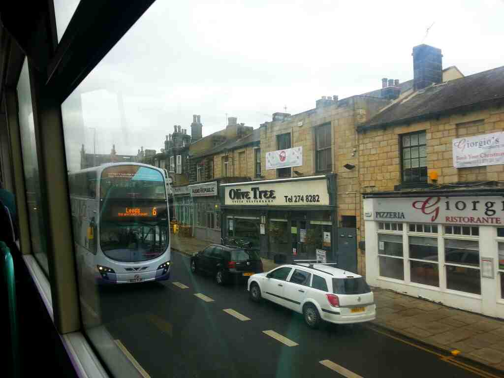 Passing the Olive tree restaurant Otley Rd Leeds number 6 bus traveling from Holt Park to leeds can be seen in this shot