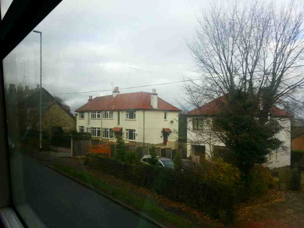 Passing through Bramhope on the A660 Leeds Rd on a X84 bus