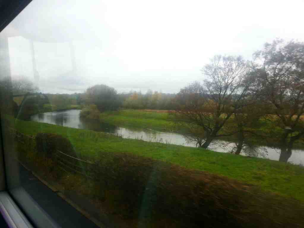Heading along the A660 between Otley and Burley in Wharfedale next to the river Wharfe on an X84 bus