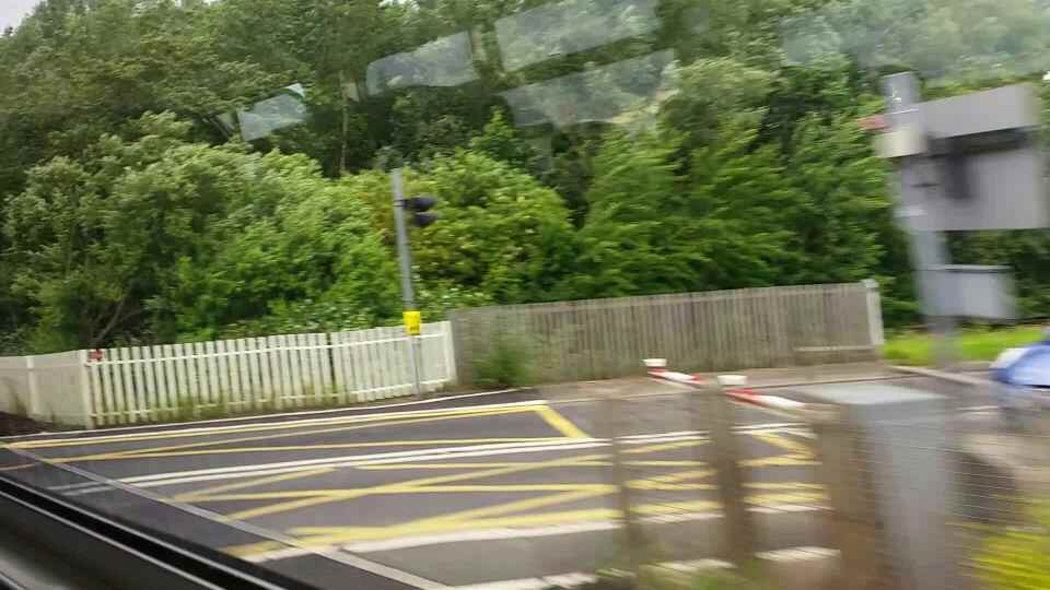 Crossing Tile Shed Lane between East Bolden and Brockley Whins on a Northern Rail Middlesbrough to Newcastle train
