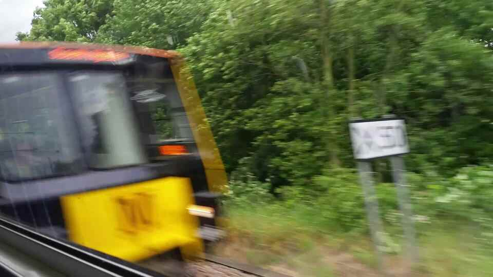 Passing a Tyne and Wear Metro train west of Tile Shed lane on a Northern Rail Middlesbrough to Newcastle train