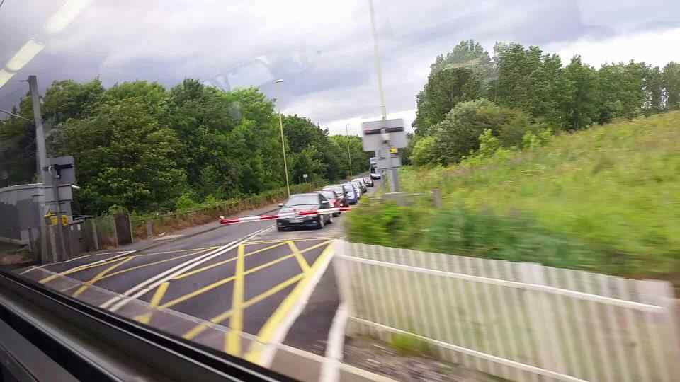 Crossing Bolden Lane between East Bolden and Brockley Whins on a Northern Rail Middlesbrough to Newcastle train