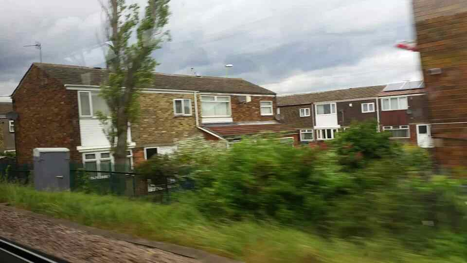 Running along Masefield Drive on a Northern Rail Middlesbrough to Newcastle train
