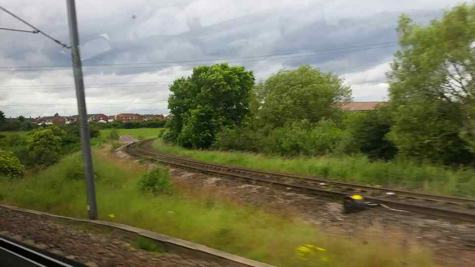 Heading past Bolden East Junction on a Northern Rail Middlesbrough to Newcastle train