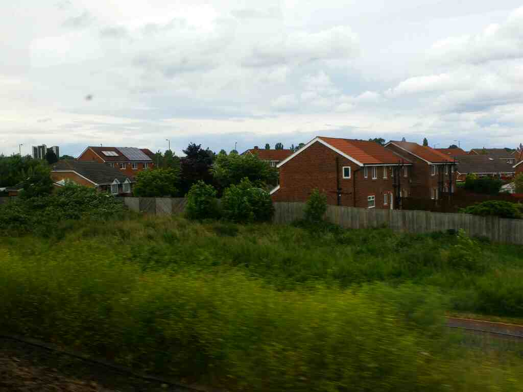Heading north away from Stockon Railway Station on a Northern Rail Middlesbrough to Newcastle train