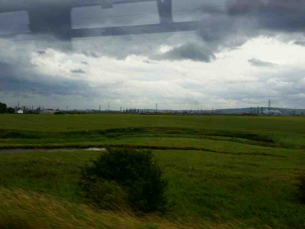 The North York Moors seen in the distance of a Northern Rail Middlesbrough to Newcastle train