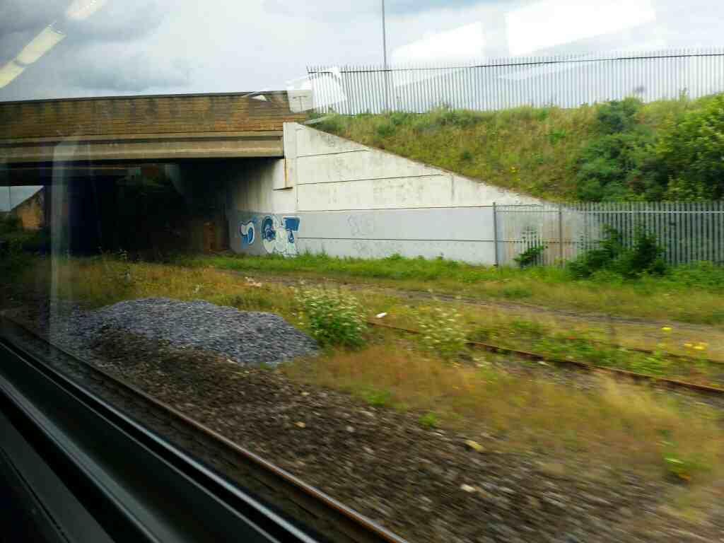 Passing under Coronation Drive the A178 Hartlepool on a Northern Rail Middlesbrough to Newcastle train