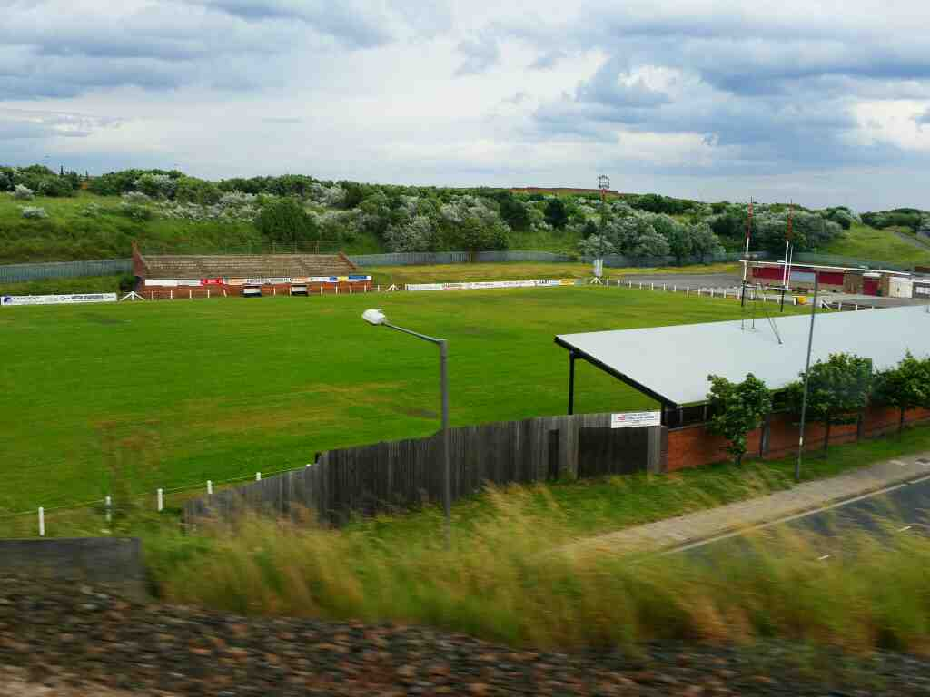 Passes Hartlepool Rovers Rugby Football Ground on a Northern Rail Middlesbrough to Newcastle train