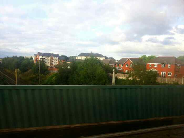 Crossing the West Coast maimline as we leave Warrington Central