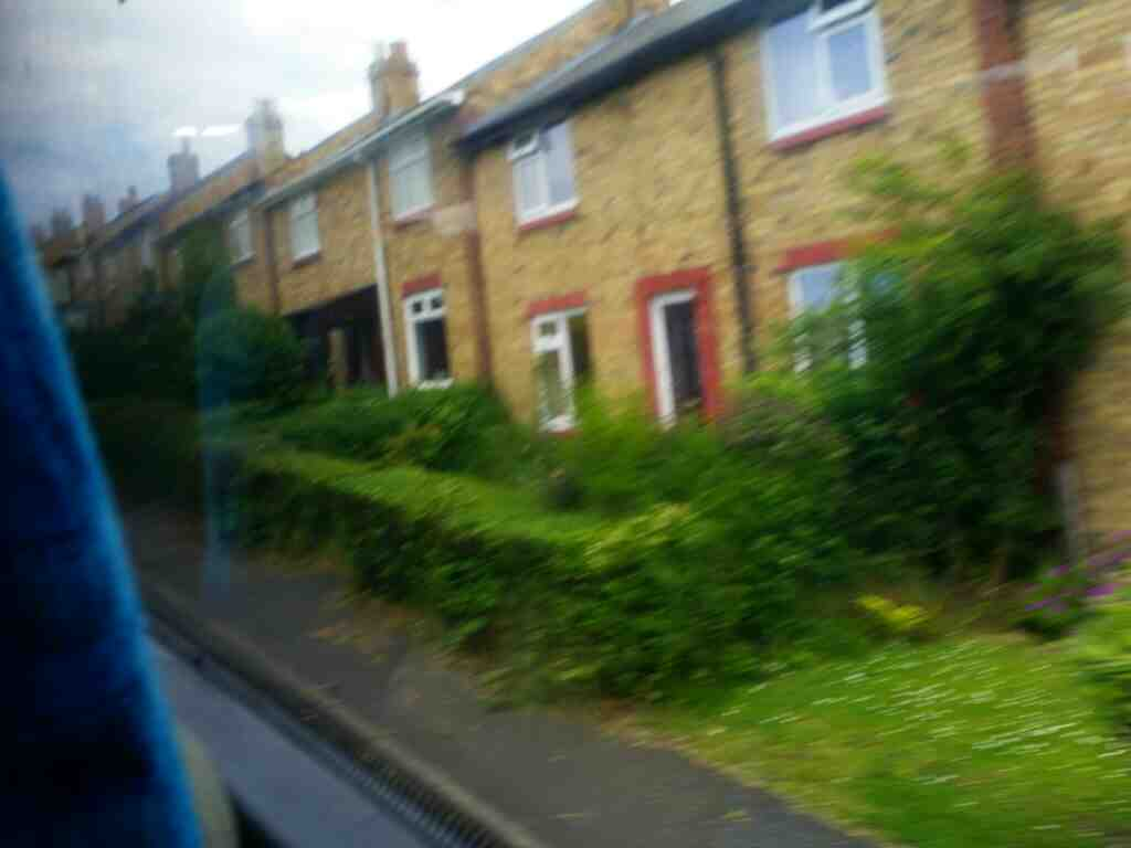 Houses on Beacon Rd Shilbottle on a X15 Newcastle to Berwick bus