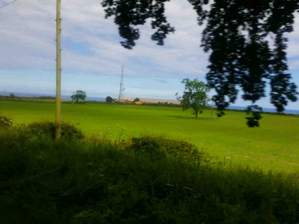 Unamed road and views of the sea just south of Shilbottle on a X15 Newcastle to Berwick bus