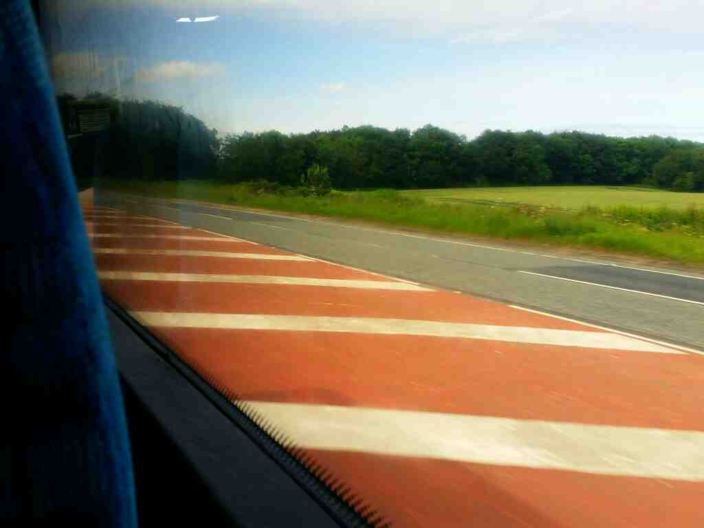 The Brownieside bypass narrowing down to two lane road on a X15 Newcastle to Berwick bus