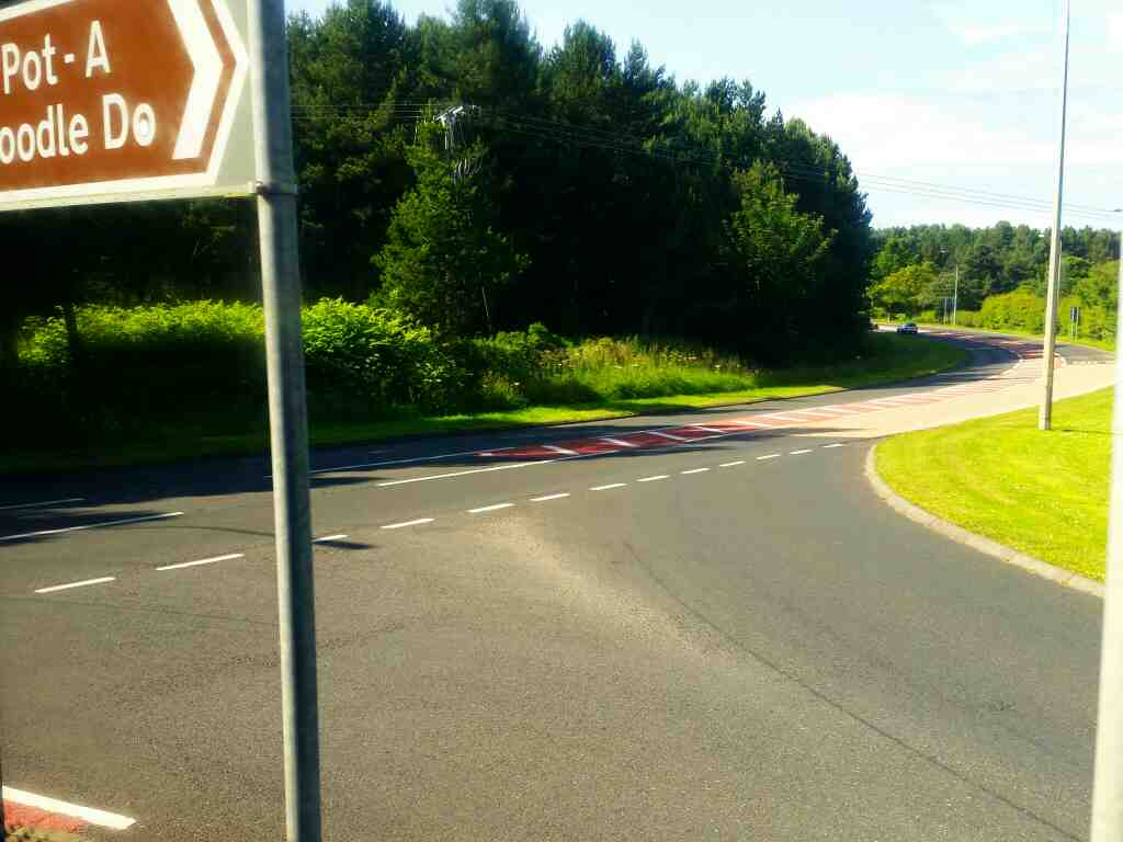 junction of the road to Scremerston off the A1167 on a X15 Newcastle to Berwick bus
