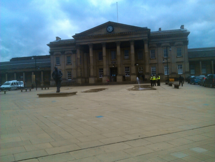 Huddersfield railway  station. The statue of Harold Wilson can be seen in this picture.