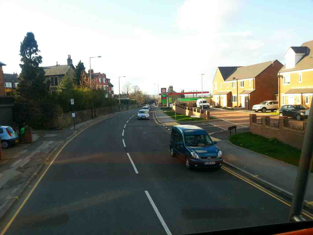 Passes filling station and Willon Walk Upper Sheffield Road the A61 Barnsley on a 265 bus