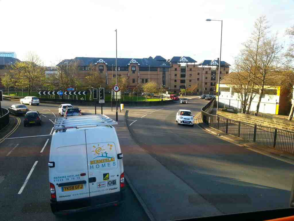 Junction of West Way Harborough Hill Rd and the A61 and Sheffield Rd the A61 Barnsley at the Alhambra Roundabout. and the Alhambra Shopping Centre can be seen in this shot off a 265 bus