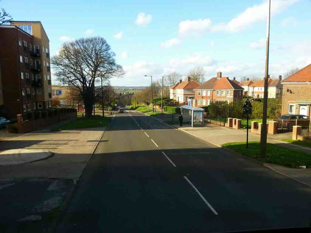 Barnsley Rd heading north through Sheffield Lane Top on a 265 bus