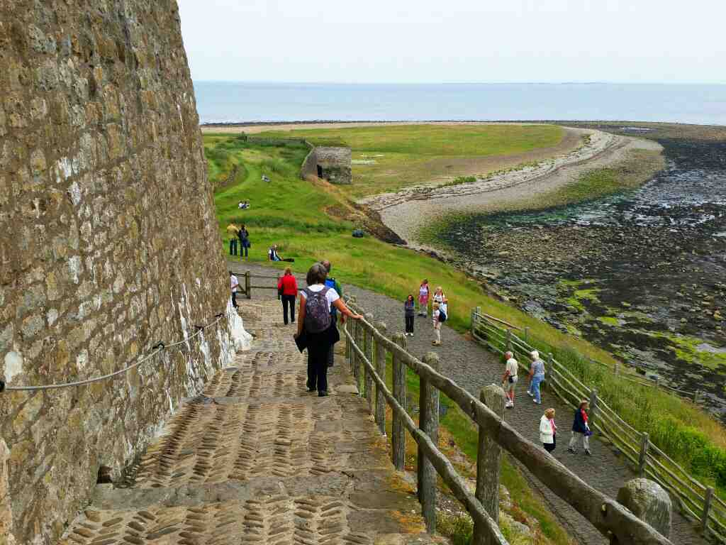 Heading down the path from Lindisfarne Castle Holy Island Northumberland