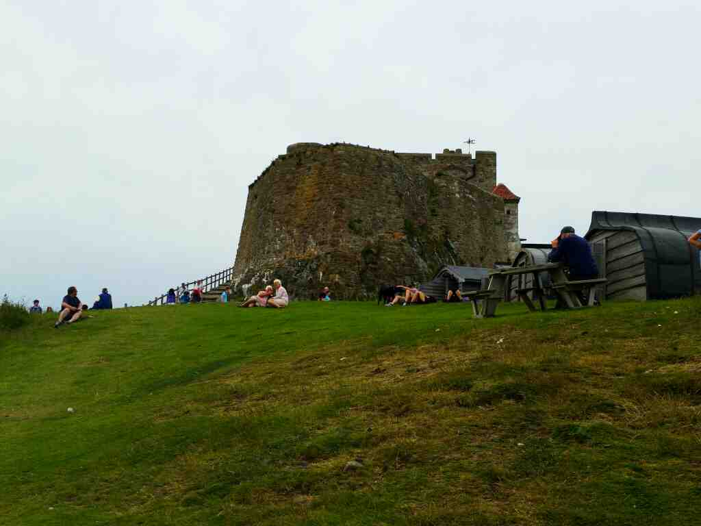 Looking back at the castle from the path to the sea Lindisfarne Castle Holy Island Northumberland