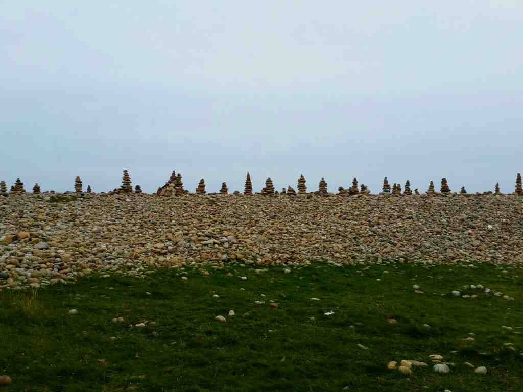 Stone statues on the beach Lindisfarne Castle Holy Island Northumberland