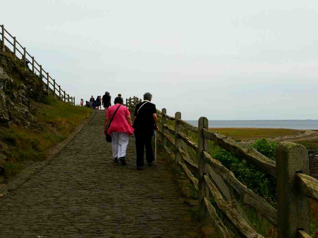Yhe path up to Lindisfarne Castle Holy Island Northumberland