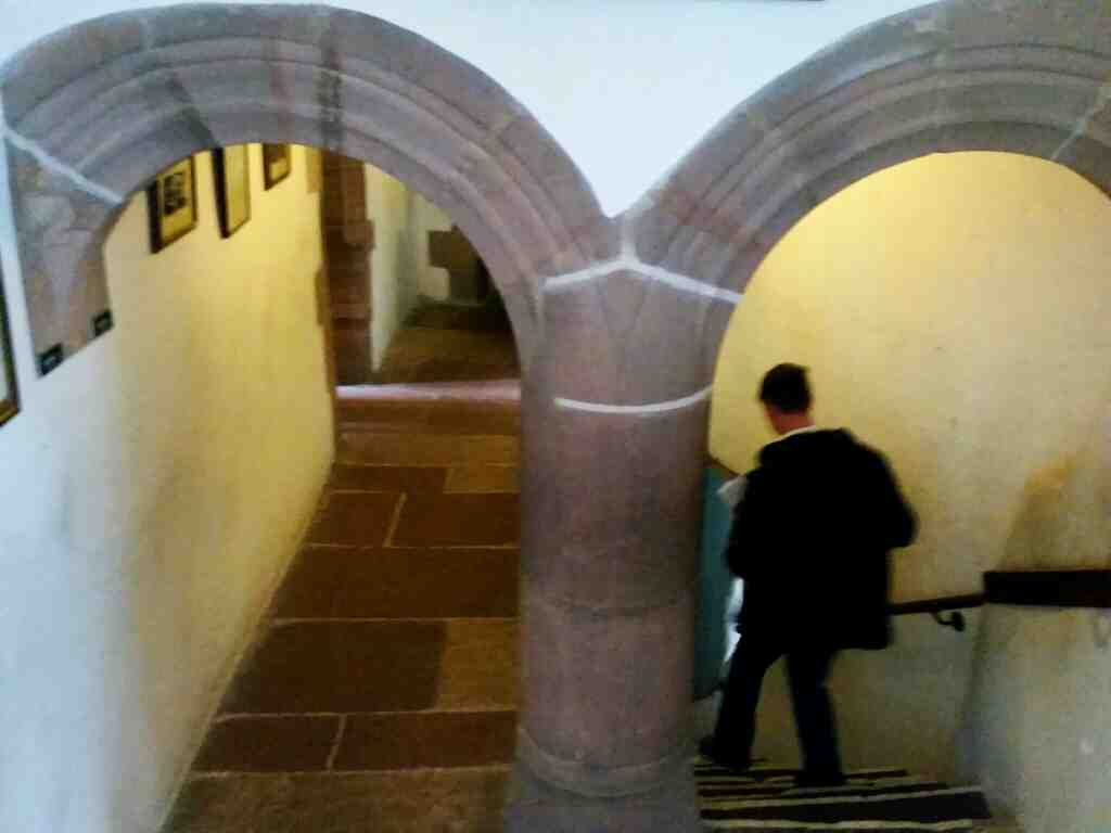 loooking back down the stairs from theong gallery Lindisfarne Castle Holy Island Northumberland